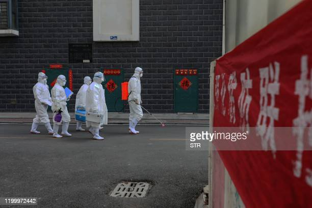 This photo taken on February 10 2020 shows a laboratory technician making their way during an epidemiological investigation in Linyi in China's...