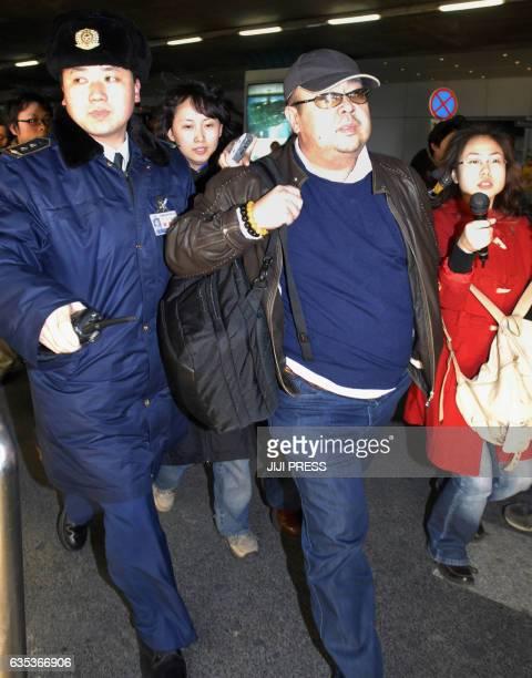 This photo taken on February 11 2007 shows a man believed to be thenNorth Korean leader Kim JongIl's eldest son Kim JongNam walking amongst...