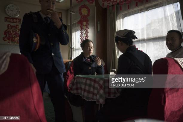 TOPSHOT This photo taken on February 11 2018 shows Chinese crew on the 26hour train that travels from Beijing to Chengdu resting before starting...