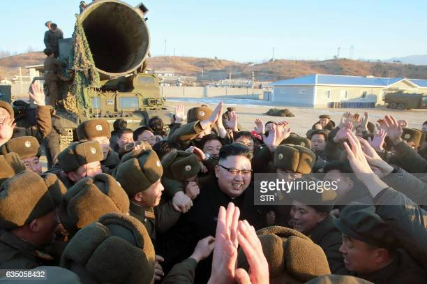 This photo taken on February 12 2017 and released on February 13 by North Korea's official Korean Central News Agency shows North Korean leader Kim...