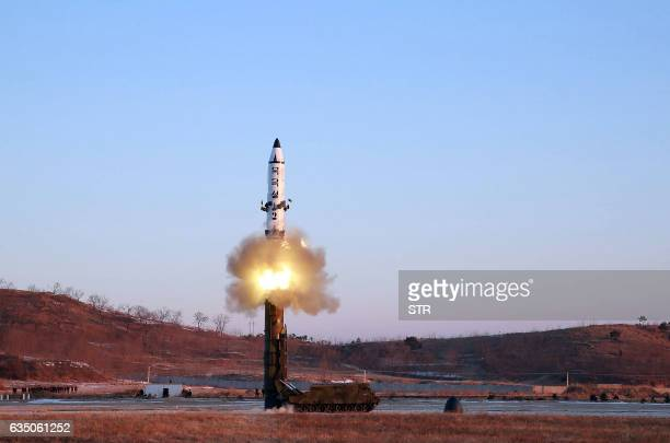 This photo taken on February 12 2017 and released on February 13 by North Korea's official Korean Central News Agency shows the launch of a...