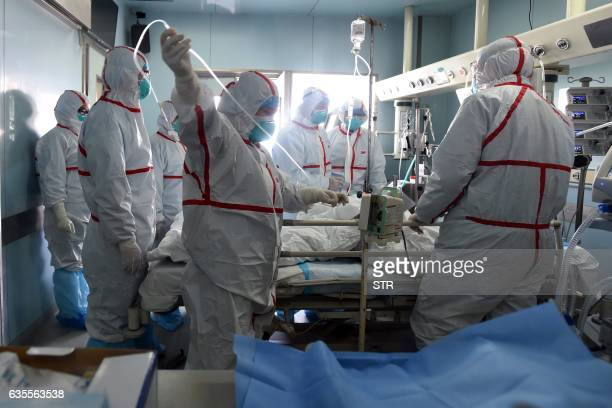 This photo taken on February 12, 2017 shows an H7N9 bird flu patient being treated in a hospital in Wuhan, central China's Hubei province. China is...