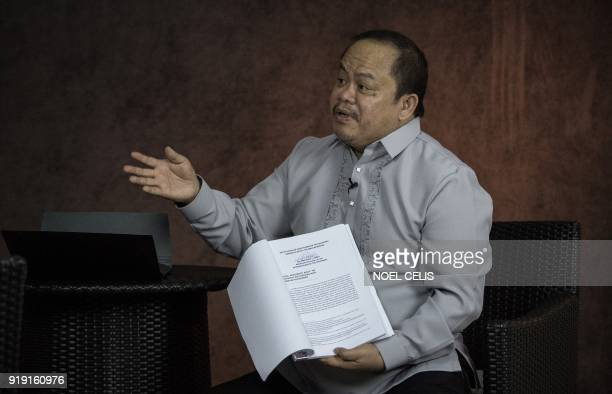 This photo taken on February 16 2018 shows lawyer Jude Sabio gesturing as he shows the communication he submitted to the International Criminal Court...