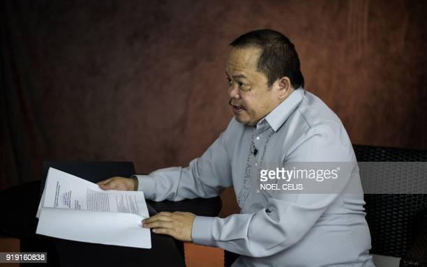 This photo taken on February 16 2018 shows lawyer Jude Sabio displaying the communication he submitted to the International Criminal Court against...