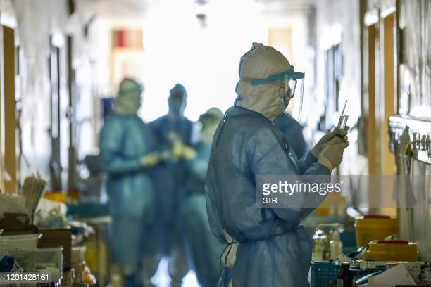 This photo taken on February 16 2020 shows medical staff members working at the isolation ward of the Wuhan Red Cross Hospital in Wuhan in China's...