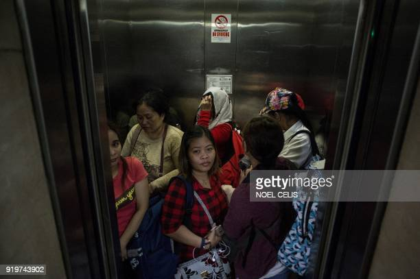 This photo taken on February 17 2018 shows Filipina workers returning home from Kuwait in the lift at the Overseas Workers Welfare Administration...