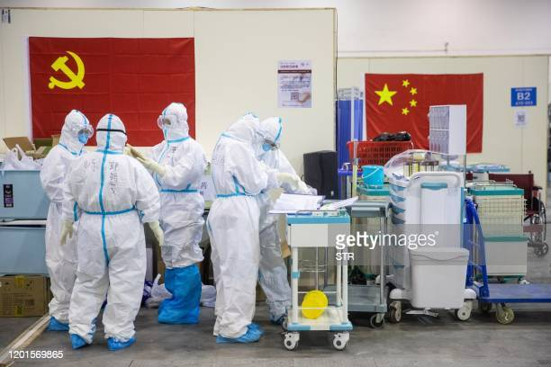 This photo taken on February 17 2020 shows medical staff members working at an exhibition centre converted into a hospital in Wuhan in China's...