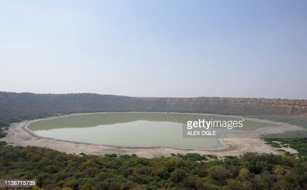This photo taken on February 19 shows Lonar Crater and its saline lake in India's Maharashtra state, the remnant of an asteroid impact around 50,000...