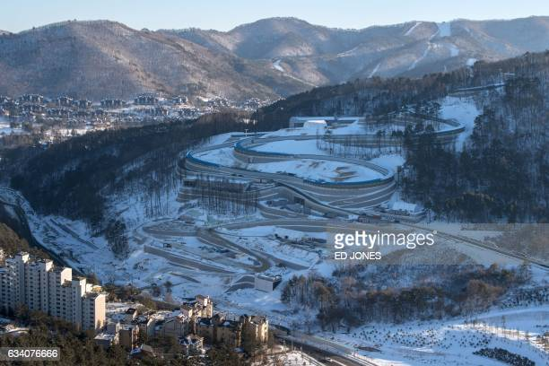 TOPSHOT This photo taken on February 2 2017 shows a general view of the luge venue from the ski jump tower of the 2018 Pyeongchang Winter Olympic...