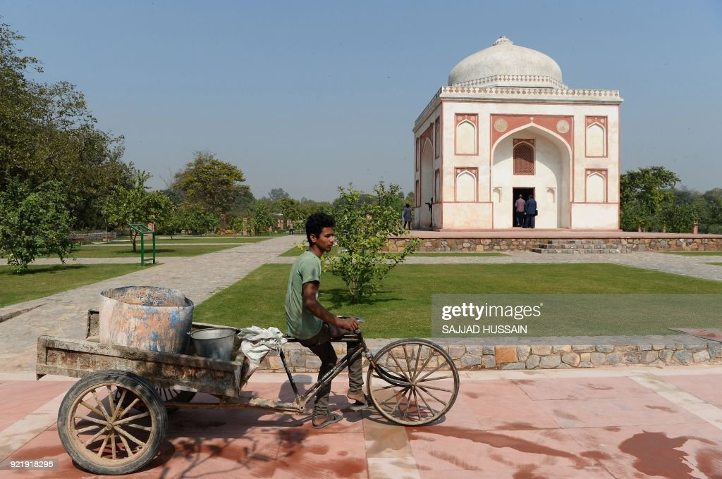 This photo taken on February 20, 2018 shows the renovated Sunderwala Burj tomb in Sunder Nursery, a 16th-century heritage garden complex adjacent to Indian UNESCO site Humayun's Tomb, in New Delhi. A once forgotten Mughal garden in the heart of New Delhi will reopen on February 21 after years of painstaking conservation work, creating a new public park in India's sprawling and smog-choked capital. The 90-acre (36-hectare) garden will be formally opened by the Aga Khan, whose Trust for Culture has helped recreate the classical garden and restore its crumbling 16th-century monuments. PHOTO / Sajjad HUSSAIN