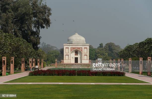 This photo taken on February 20 2018 shows the renovated Sunderwala Burj tomb in Sunder Nursery a 16thcentury heritage garden complex adjacent to...