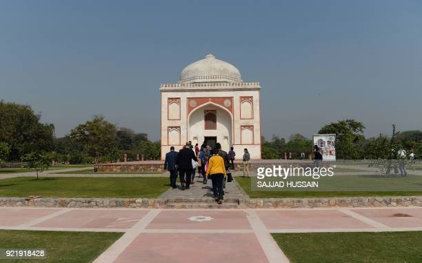 This photo taken on February 20 2018 shows visitors walking towards the renovated Sunderwala Burj tomb in Sunder Nursery a 16thcentury heritage...