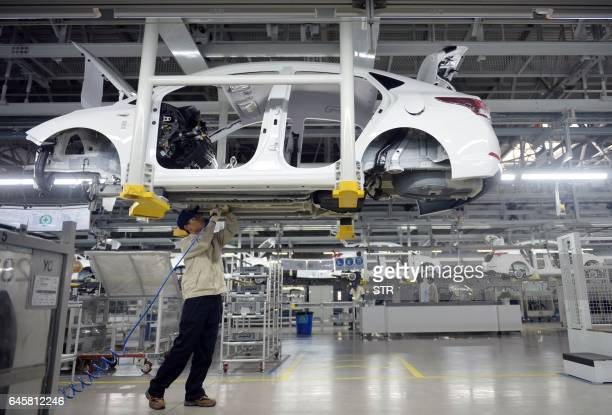 This photo taken on February 21 2017 shows a worker in a Hyundai factory in Cangzhou in China's northern Hebei province The factory is the South...