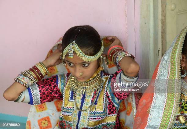 This photo taken on February 22 2018 shows an Indian artist looking on as she makes traditional Banni embroidery at a workshop at Hodka village in...