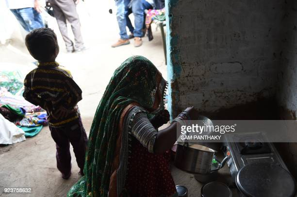 This photo taken on February 22 2018 shows an Indian artist making tea at a workshop producing traditional Banni embroidery at Hodka village in the...