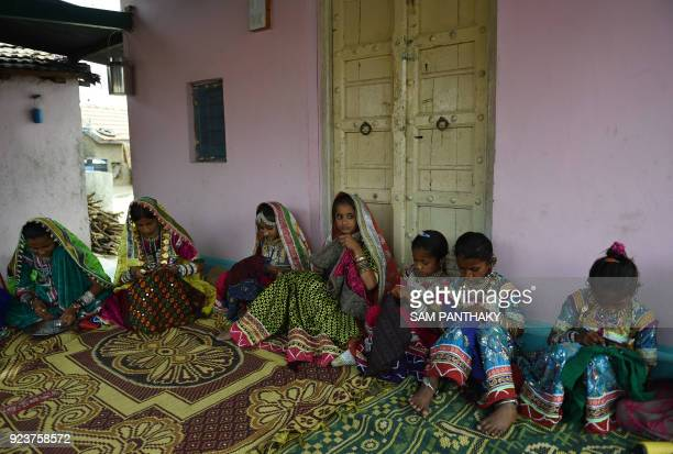 This photo taken on February 22 2018 shows Indian artists making traditional Banni embroidery at a workshop at Hodka village in the Kutch district of...