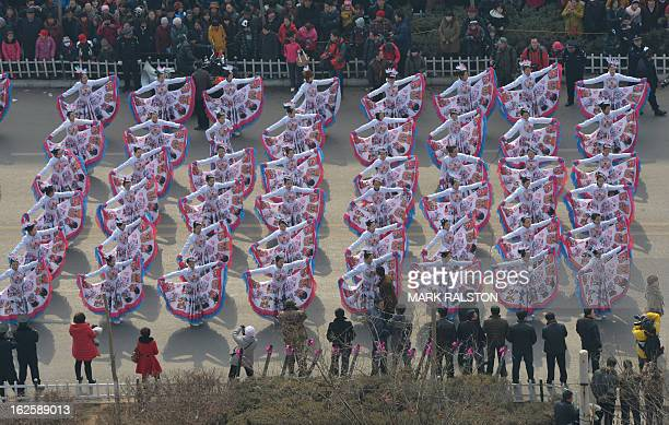 This photo taken on February 24 2013 shows Chinese entertainers watched by a large crowd as they perform a dance during the traditional Lantern...