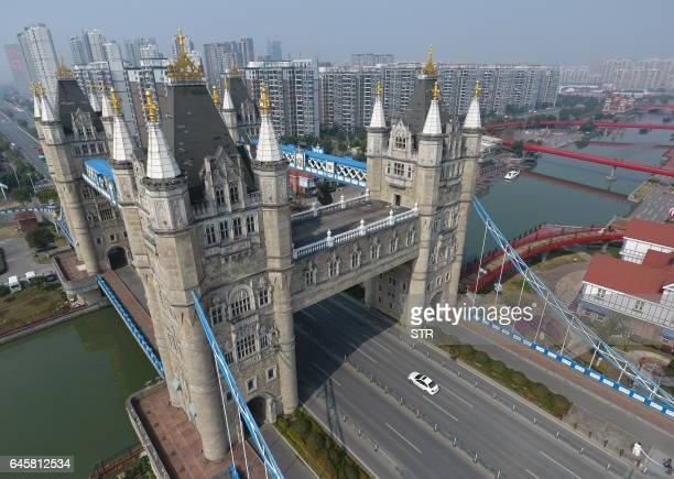 This photo taken on February 25 2017 shows a bridge modeled on London's Tower Bridge in Suzhou in China's eastern Jiangsu province The bridge...