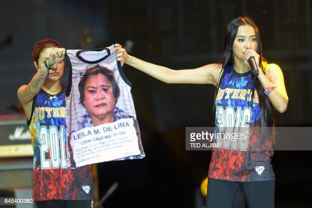 This photo taken on February 25 2017 shows Mocha Uson a blogger and supporter of Philippine President Rodrigo Duterte onstage with her colleague...