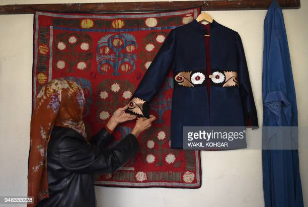 This photo taken on February 25 2018 shows an Afghan tailor hanging an embroidered coat on the wall at Zarif Design House in Kabul Cheap Chinesemade...
