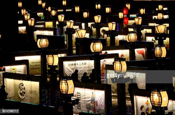 This photo taken on February 25, 2018 shows people visiting a lantern show in Zhangye in China's northwestern Gansu province as the Lunar New Year...