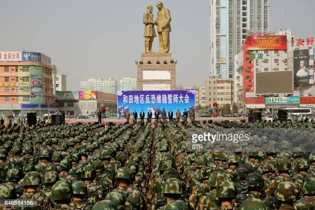 TOPSHOT This photo taken on February 27 2017 shows Chinese military police attending an antiterrorist oathtaking rally in Hetian northwest China's...