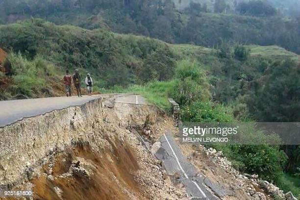This photo taken on February 27 2018 and received on February 28 shows damage to a road near Mendi in Papua New Guinea's highlands region after a...