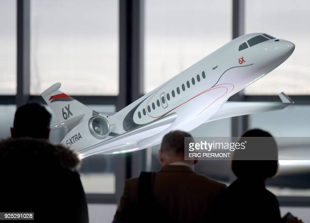 This photo taken on February 28, 2018 at Le Bourget airport shows the model of the future Dassault Aviation's Falcon 6X jet, presented during a press...
