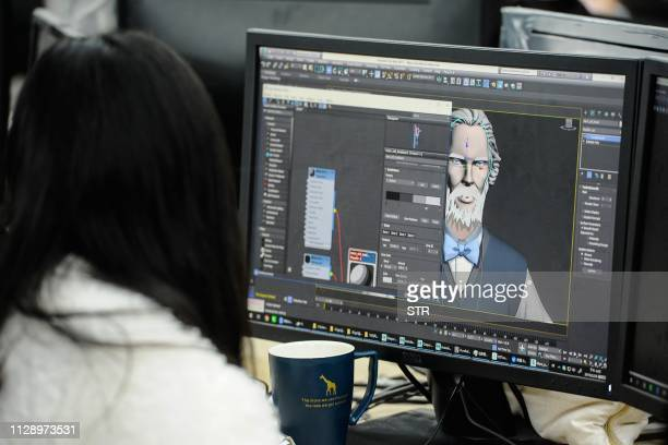 This photo taken on February 28 2019 shows a staff member working on the online cartoon series The Leader at the Wawayu animation studio in Hangzhou...