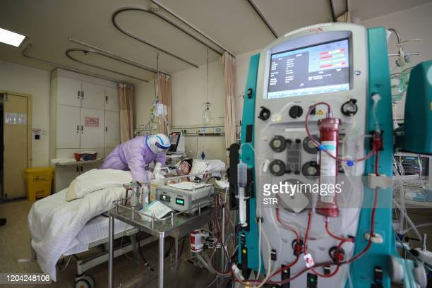This photo taken on February 28 2020 shows a patient infected by the COVID19 coronavirus receiving treatment by an Extracorporeal membrane...