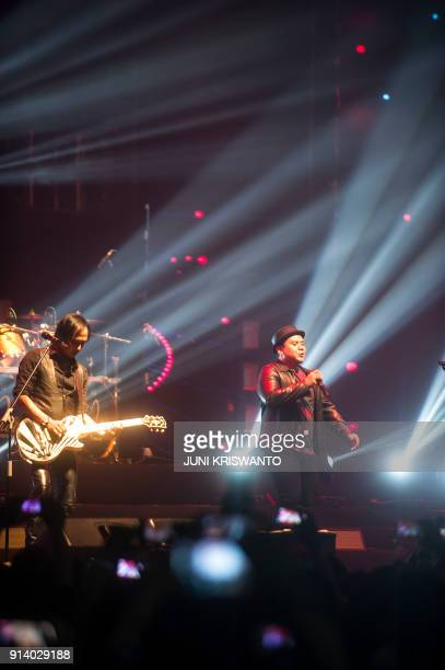 This photo taken on February 3 2018 shows Indonesian pop rock band Padi Reborn performing during a concert in Surabaya / AFP PHOTO / Juni Kriswanto