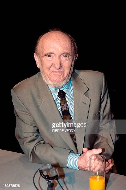 This photo taken on February 4, 1996 in Paris, shows French geneticist and philosopher Albert Jacquard posing on the set of the French television...