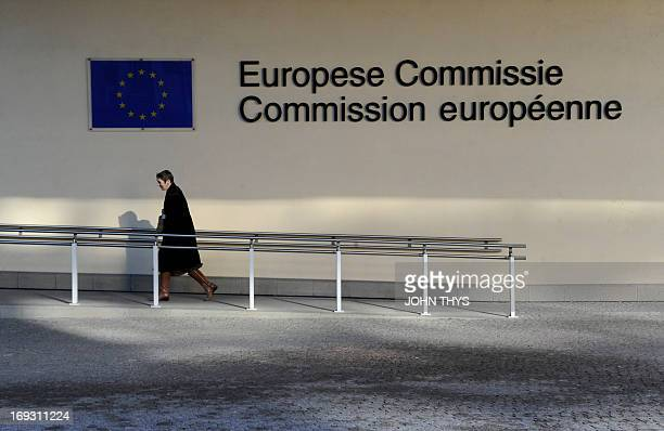 This photo taken on February 8 2011 shows a man walking in front of the European Union Commission building at the EU Headquarters in Brussels AFP...