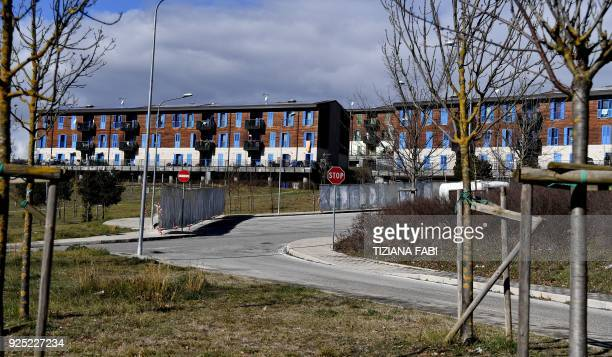 This photo taken on February 8, 2018 shows Bazzano, dubbed New Town, near L'Aquila, featuring new urban housing created after the 2009 earthquake....