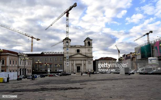 This photo taken on February 8, 2018 shows in L'Aquila, central Italy, shows ongoing reconstruction efforts in the town centre following the 2009...