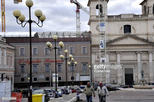 This photo taken on February 8 2018 shows in L'Aquila central Italy shows ongoing reconstruction efforts in the town centre following the 2009...