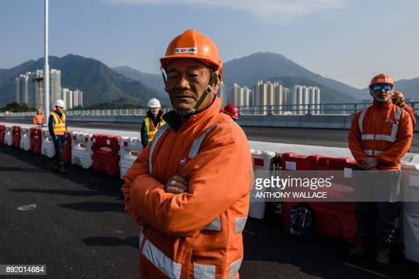 This photo taken on February 9 2017 shows a worker walking on the Hong Kong Link Road of the Hong KongZhuhaiMacau Bridge in Tung Chung Hong Kong...
