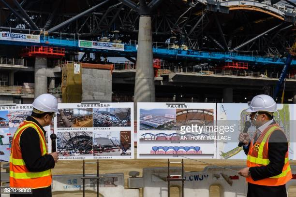 This photo taken on February 9 2017 shows artist illustrations and photos displayed during a press briefing on a construction site for the Hong Kong...