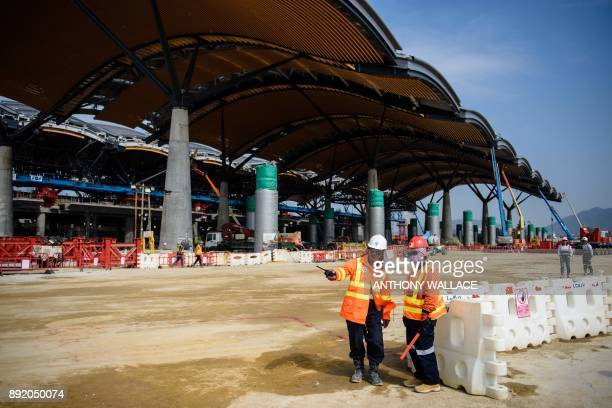 This photo taken on February 9 2017 shows labourers working on a construction site for the Hong Kong Boundary Crossing Facilities of the Hong...