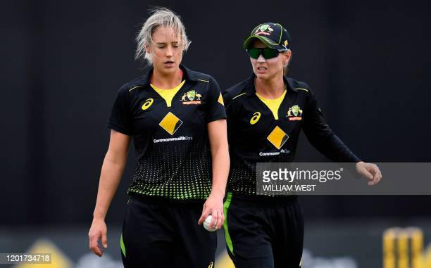 This photo taken on February 9 2020 shows Australian captain Meg Lanning and allrounder Ellyse Perry talking during a cricket match against England...