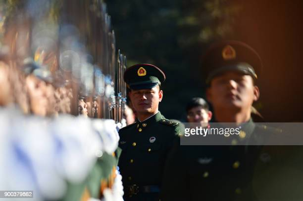This photo taken on January 1 2018 shows members of the Chinese People's Liberation Army honour guard training at the Working People's Cultural...