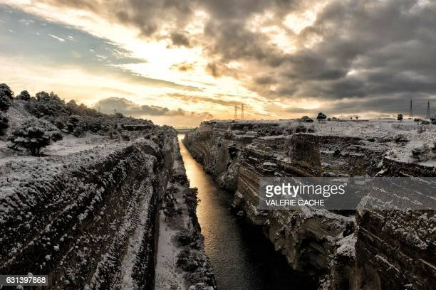 TOPSHOT This photo taken on January 10 2017 shows a snowcovered Corinth Canal near the city of Corinth A cold snap gripping Europe has killed more...