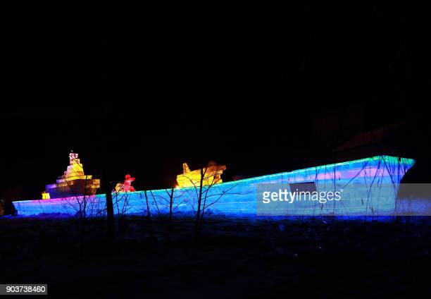 This photo taken on January 10 2018 shows an ice sculptured aircraft carrier 'Liaoning' displayed at the Qipanshan Ice and Snow World during the...