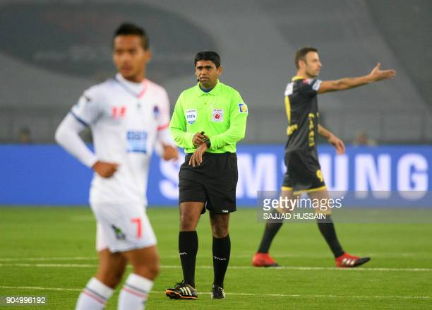 This photo taken on January 10 2018 shows an Indian referee during the Indian Super League football match between the Delhi Dynamos FC and Kerala...