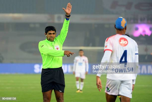 This photo taken on January 10 2018 shows an Indian referee gesturing towards a player during the Indian Super League football match between the...