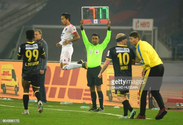 This photo taken on January 10 2018 shows an Indian referee holding up the substitute board during the Indian Super League football match between the...