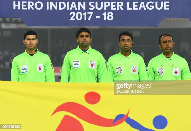 This photo taken on January 10 2018 shows Indian referees standing for the national anthem during the Indian Super League football match between the...