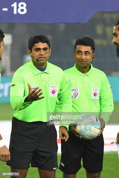 This photo taken on January 10 2018 shows Indian referees tossing the coin before the start of Indian Super League football match between the Delhi...
