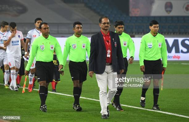 This photo taken on January 10 2018 shows Indian referees walking out onto the pitch during the Indian Super League football match between the Delhi...