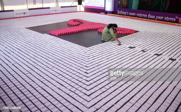 This photo taken on January 10 2019 shows an Indian woman arranging sanitary napkins during an attempt to enter the Guinness World Record by creating...